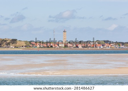 Lighthouse Brandaris and the village West Terschelling on Terschelling - stock photo