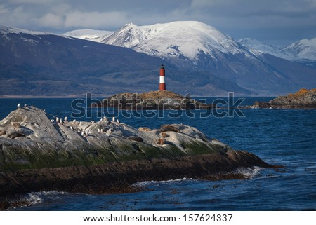 Lighthouse End of the world in the Beagle Channel, Ushuaia, Pata - stock photo