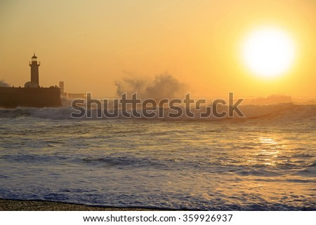 Lighthouse Felgueirasin Porto with waves and sun at sunset