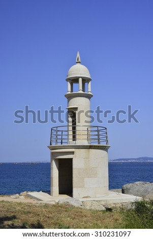 lighthouse in beautiful summer landscape of the Rias Baixas - stock photo