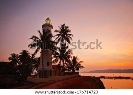 Lighthouse in fort in Galle at sunrise - Sri Lanka  - stock photo