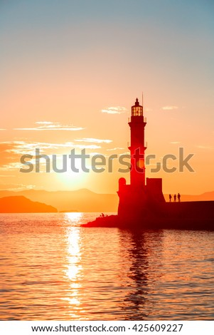 Lighthouse in old venetian harbor, port of Chania at sunset, Crete, Greece - stock photo