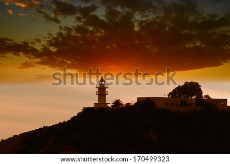Lighthouse in the coastline - stock photo