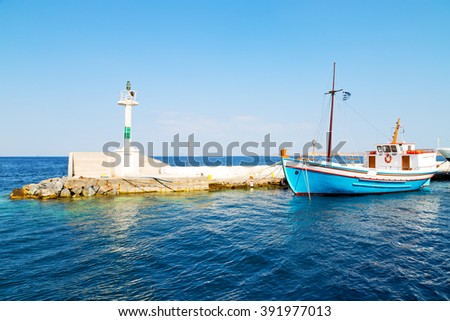 lighthouse  in the mediterranean sea cruise greece island in santorini europe boat harbor and pier - stock photo