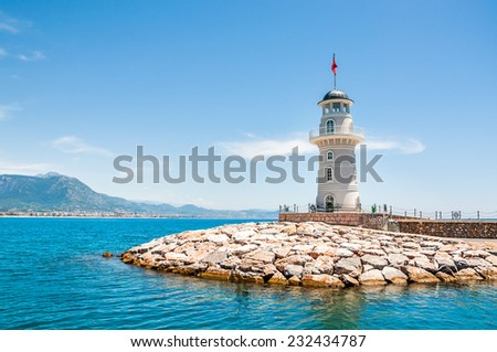 Lighthouse in the port of Alanya, Turkey. Beautiful summer landscape with sea beach - stock photo