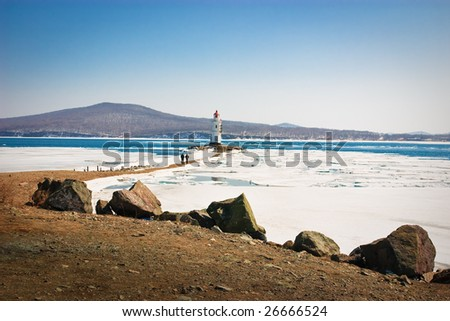 Lighthouse in winter - stock photo