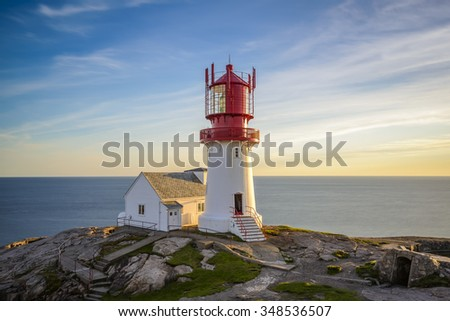 Lighthouse Lindesnes Fyr at sunset on most southern point of Norway - stock photo