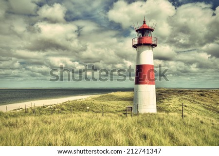 Lighthouse List and beautiful coastal landscape of the german North Sea Island Sylt, HDR, Germany, Europe, vintage style, Leuchtturm List auf der Nordseeinsel Sylt, Deutschland, Europa - stock photo