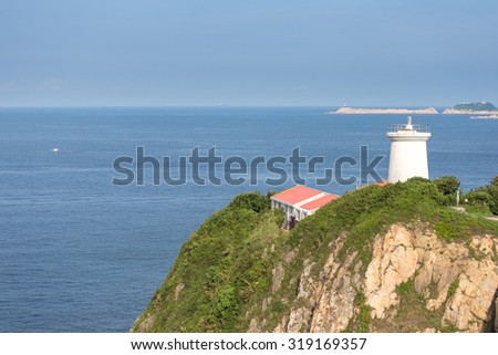 Lighthouse nearby the ocean in Hongkong - stock photo