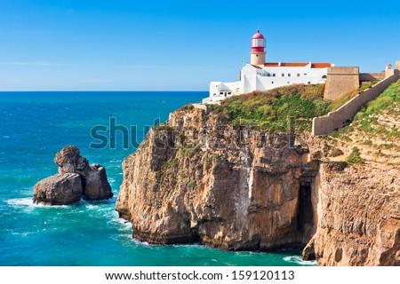 Lighthouse of Cabo Sao Vicente, Sagres, Portugal - Farol do Cabo Sao Vicente (built in october 1851) - stock photo