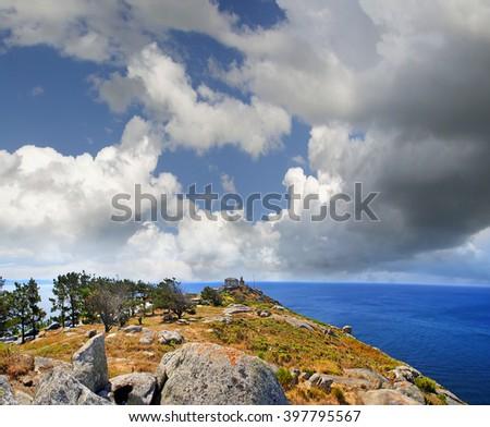 Lighthouse of Fisterra, La Coruna, Galicia, Spain - the Pilgrim's Road to Santiago de Compostela - stock photo