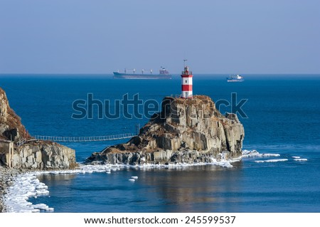 Lighthouse on a cliff by the sea. East (Japan) Sea - stock photo
