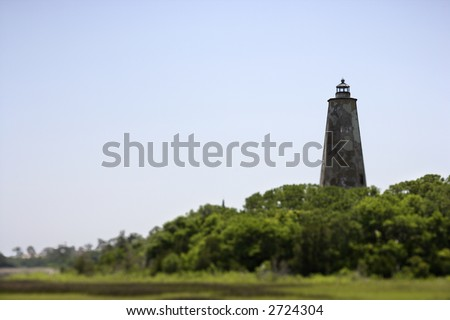 Lighthouse on Bald Head Island, North Carolina. - stock photo