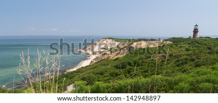 Lighthouse on Cliff - stock photo