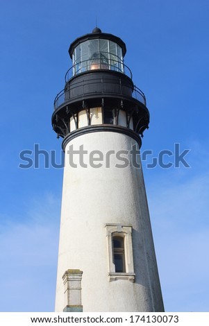 Lighthouse on Oregon Coast in Yaquina Head - an outstanding Natural Area - stock photo