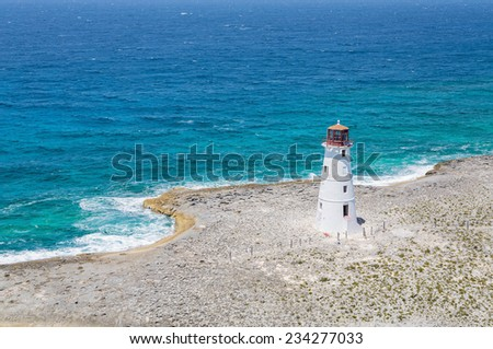 Lighthouse on Point of land near Nassau on Grand Bahamas - stock photo