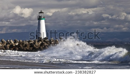 Lighthouse on Santa Cruz Shore - stock photo