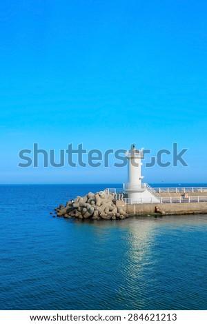 Lighthouse on sea.Seascape and blue sky - stock photo