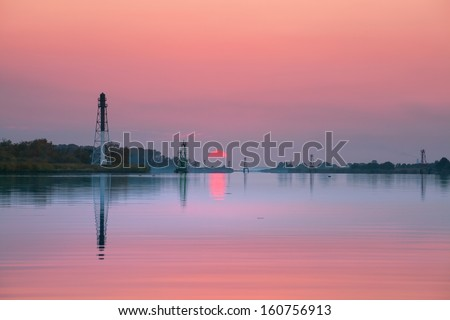 Lighthouse on shores - stock photo