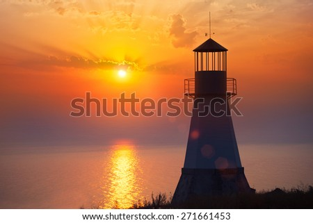 Lighthouse on sunset - stock photo