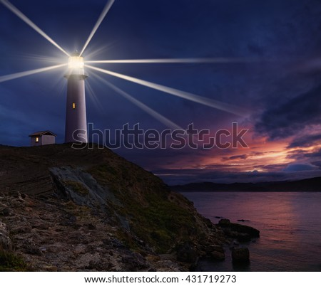 Lighthouse on the island against night sky - stock photo