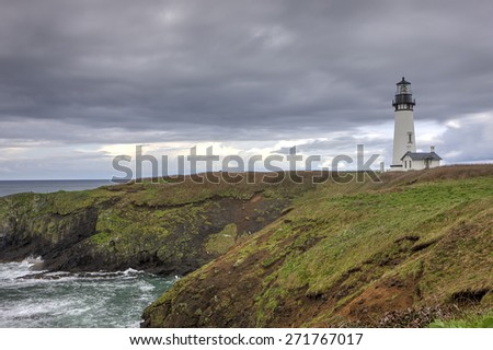 Lighthouse on the pacific coast in Newport, Oregon. - stock photo