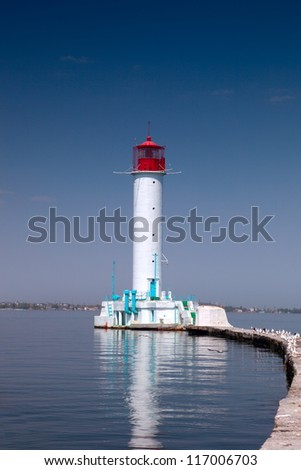 Lighthouse on the quarantine pier at the Odessa sea port on the Black Sea. - stock photo