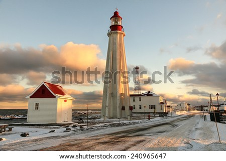 Lighthouse Pointe-au-Pere, Quebec, Canada Pointe-au-Pere (EN: Father Point) is a district of the city of Rimouski, Quebec, which is located in eastern Quebec at the mouth of the St. Lawrence River. - stock photo
