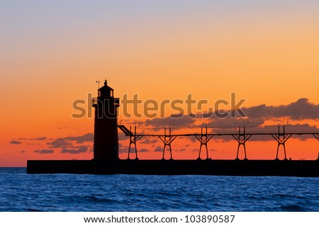 Lighthouse silhouette. Image of a lighthouse silhouette at sunset. - stock photo