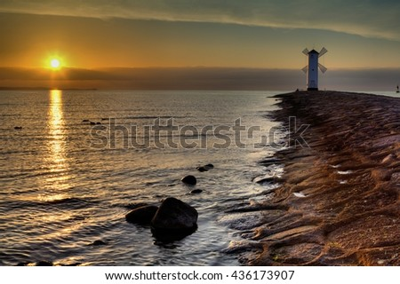 Lighthouse windmill Stawa Mlyny, Swinoujscie, Baltic Sea, Poland - stock photo