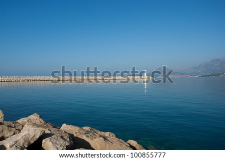 Lighthouse with blue sky and sea - stock photo