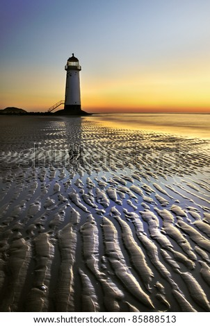 lighthouse with fantastic sunset - stock photo