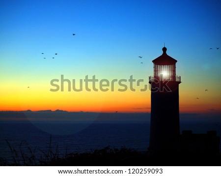 Lighthouse with Lens Flare on the Washington Coast at Sunset - stock photo