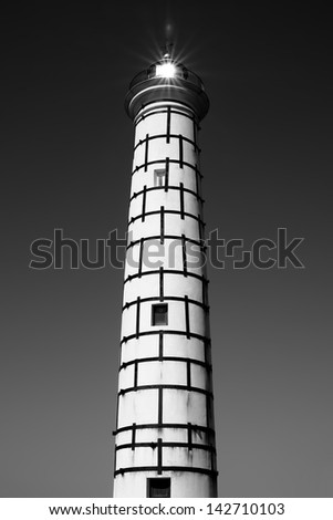 lighthouse with real sun flare - stock photo