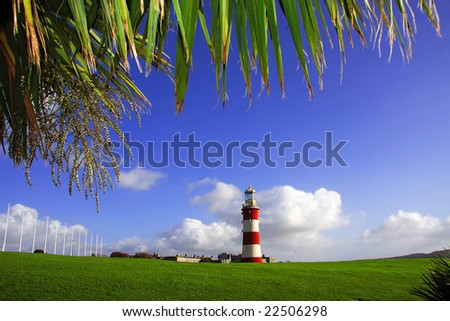 lighthouse with tropic palm, Plymouth, UK - stock photo