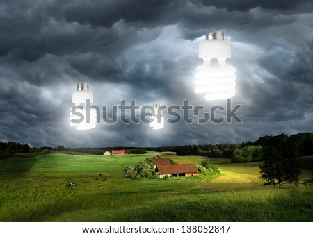 lighting bulbs on the sky over the farms - stock photo