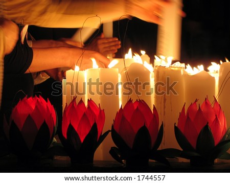 Lighting Candles on Buddha's Birthday - stock photo