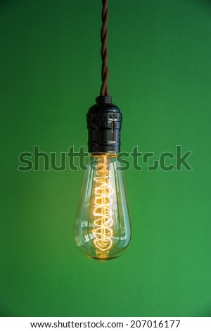 Lighting Decor on Green Background - stock photo