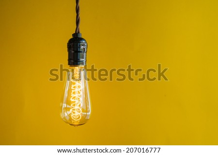 Lighting Decor on Yellow Background - stock photo