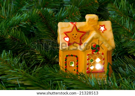 Lighting house and christmas tree, abstract holiday background - stock photo