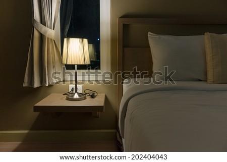 Lighting in the bedroom, bedroom decor to make it look better. - stock photo