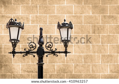 Lighting lamp. Image isolated on brick background. with clipping path - stock photo