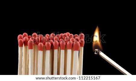 lighting matches on black background. - stock photo