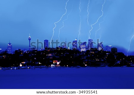 lighting over city skyline - stock photo