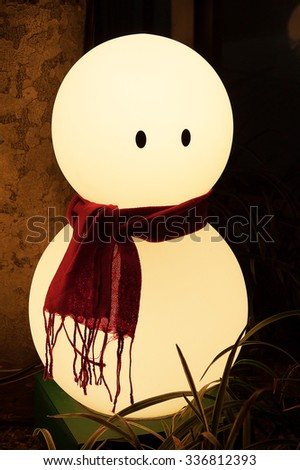lighting snow man for welcoming the Christmas - stock photo