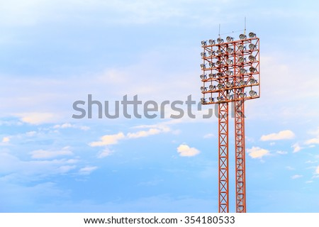 Lighting tower of stadium on sky and cloud background. - stock photo