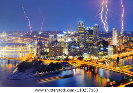 Lightning among skyscrapers in downtown PIttsburgh, Pennsylvania, USA. - stock photo