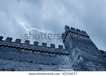 lightning and clouds over the castle - stock photo