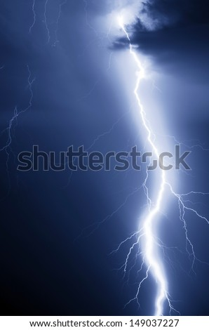 Lightning bolt at night - stock photo