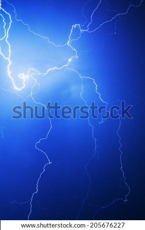 Lightning bolt in the night sky - stock photo